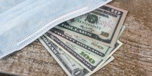 Cash under a medical mask