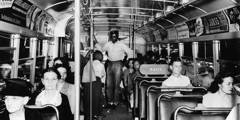 Photo of a racially segregated bus.