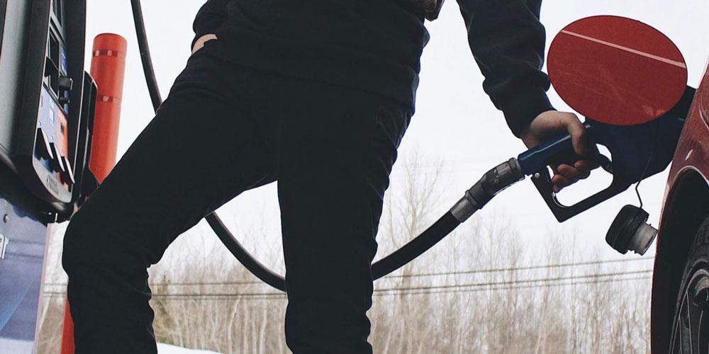 A man fuels his car