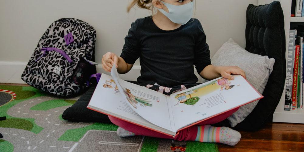 School girl in medical mask