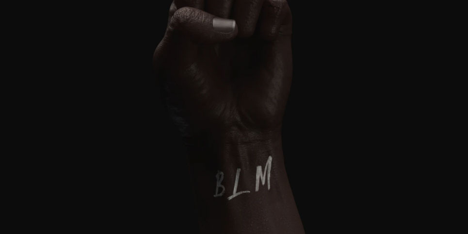 Photo of a raised fist with BLM on the wrist.