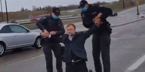 Calgary pastor arrested in the street.