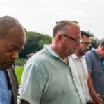 Diverse men praying
