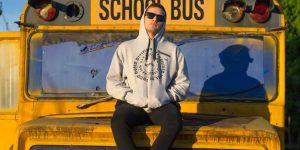 A hoodie on a beaten school bus