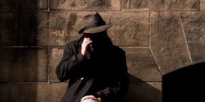 A shadowy man on the phone