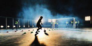 Girls playing soccer at night