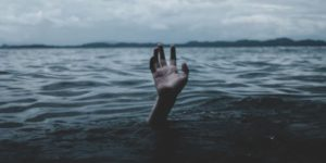 A drowning person's hand