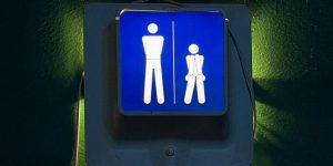A more-descriptive restroom sign