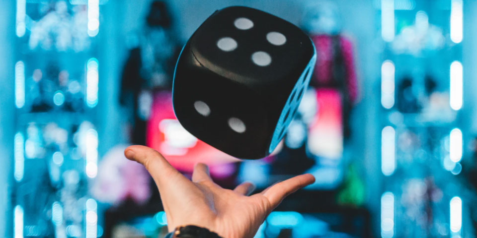 Hand throws giant die