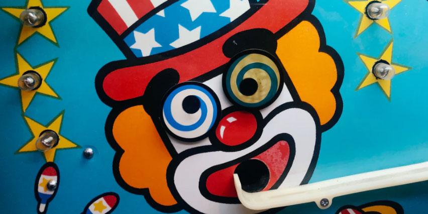 Clown face in a pinball machine