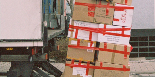 Palette of moving boxes on a truck lift