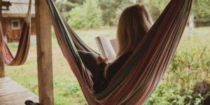 Woman reading in a hammock