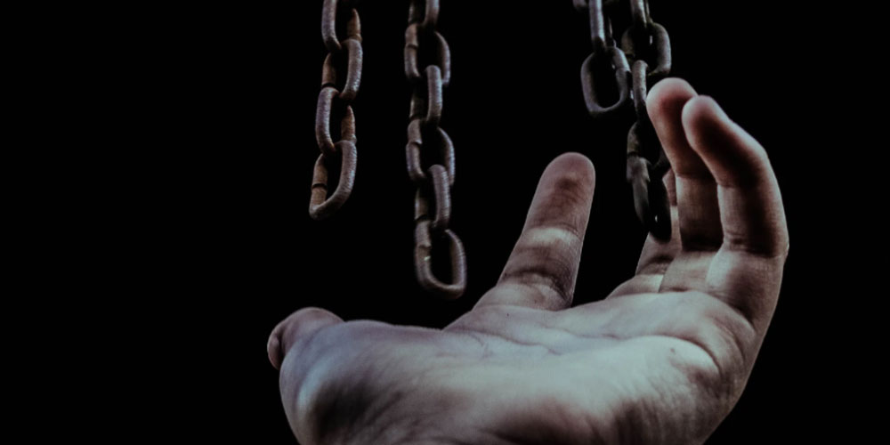 A hand reaches for chains