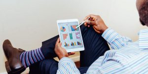 Black man reviewing business trends