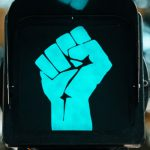 Racial conflict fist as a green light
