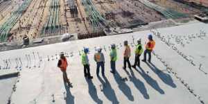 Construction workers reviewing a site