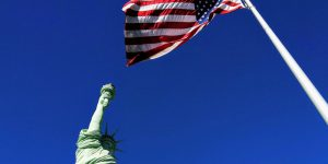The Statue of Liberty and U.S. Flag