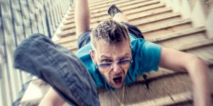 A man falls down stairs