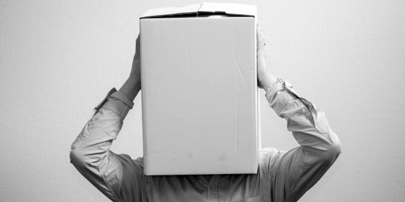 A man with his head in a box