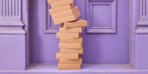 A stack of boxes outside a door