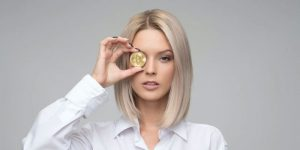 A woman with a bitcoin over her eye