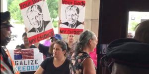 Vaccine freedom protest blocked at State House door