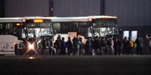 Image of illegal immigrants about to board buses in RI