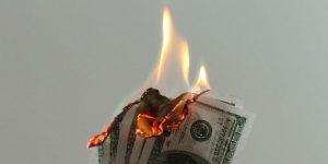 Burning $100 bills